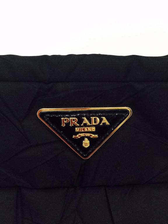 b984f42460fef Women s Prada Black Quilted Nylon Handbag With Patent Leather Handle and  Brass Hardware For Sale