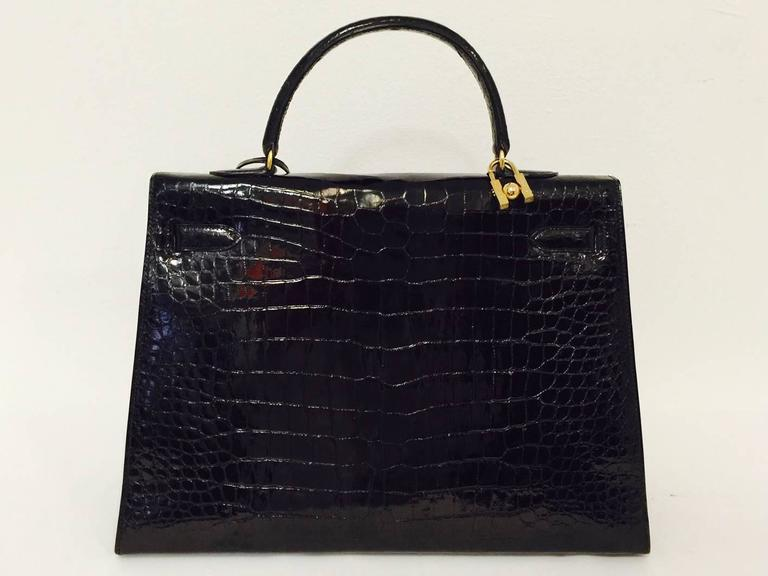 Hermes Black Shiny Crocodile Kelly 35 GHW Above Excellent Condition w. Cadena In Excellent Condition For Sale In Palm Beach, FL