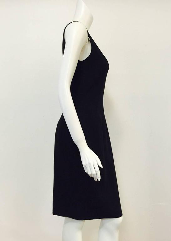 Chado Ralph Rucci designs are always feminine, classic and crafted using couture techniques.  This sleeveless sheath dress is no exception!  Features ultra-luxurious black wool, alluring, rounded neckline, above the knee length,and rear slit for