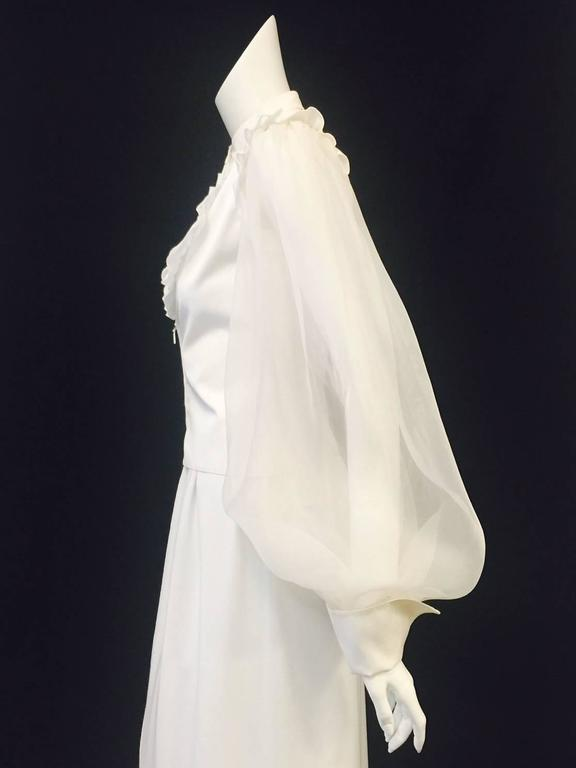 Valentino Garavani's has championed uber-feminine designs for over 50 years!  Indeed, this fitted cotton blouse is Very Valentino...features voluminous poet sleeves crafted from ivory organza, oversized french cuffs, and unexpected, zippered lower