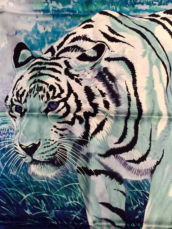 "Heed the call of the wild with Hermes Blue Silk Twill ""Tigre du Bengale"" Carre!   Designed by renowned artist Robert Dallet, this scarf has become a highly desired print by big cat lovers everywhere.  Features an unforgettable, nearly arresting"