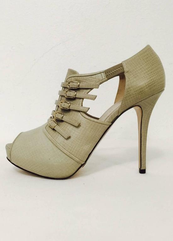 473be1fb7baa5 Edgy Escada Textured Leather Buckled High Heel Shooties
