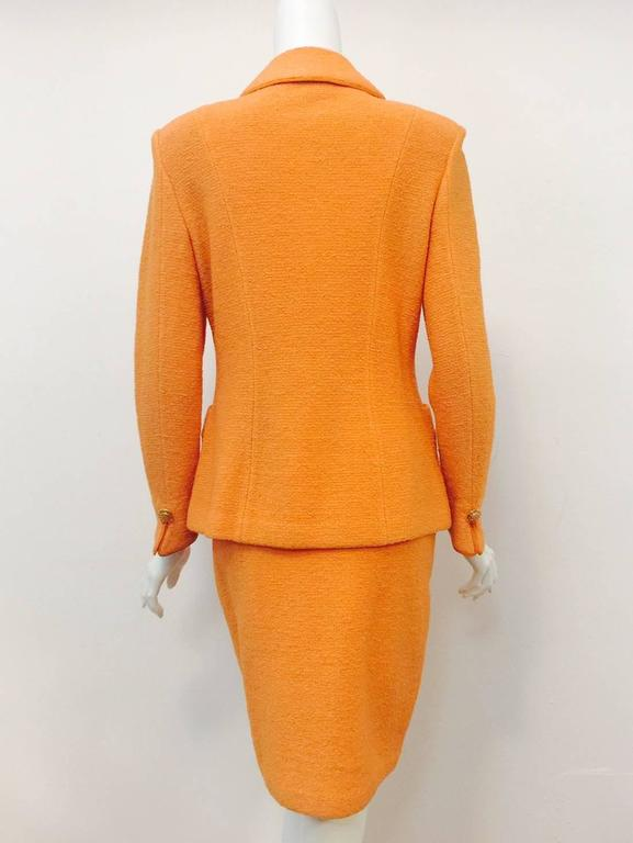 St. John Collection Orange Wool Blend Knit Skirt Suit With Enamel Buttons  In Excellent Condition For Sale In Palm Beach, FL