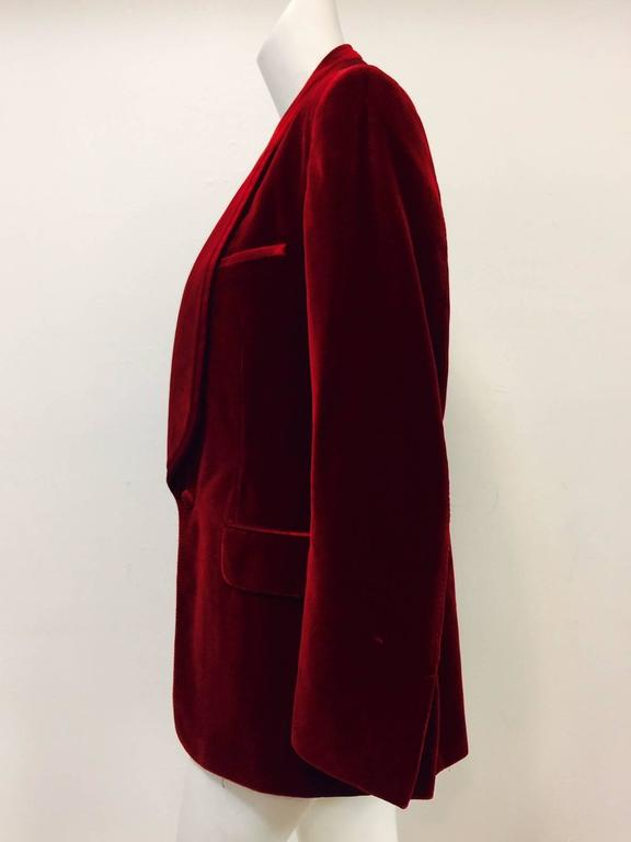 Iconic Tom Ford for Gucci rich red velvet Men's smoking jacket is highly desired by museums and collector's alike!  Features instantly recognizable design and fabrication associated with Mr. Ford's storied tenure at the house of Gucci at the turn of