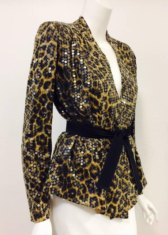 During the late 20th Century, Rome-based design team of Sergio Ognibene and Peter Zendman were well known for their comfortable yet chic designs.  This Leopard Print Belted Jacket is no exception!  Features ultra-luxurious printed silk exterior and