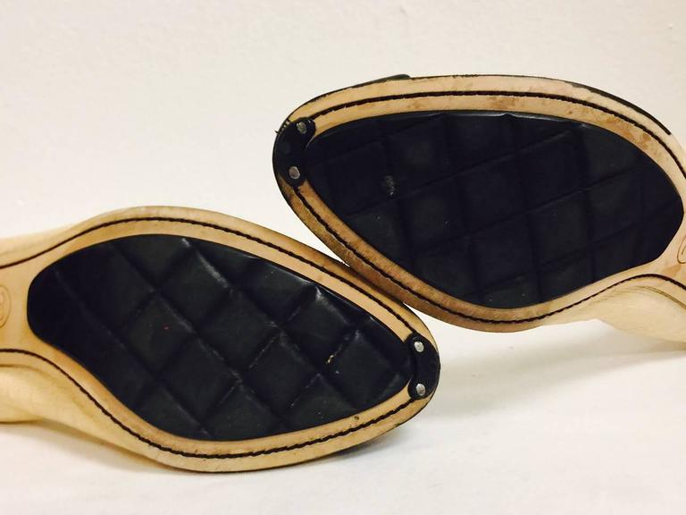 22892d90e0 Chanel Black and Tan Pumps With Antique Gold Tone Camellia Ornaments For  Sale 1
