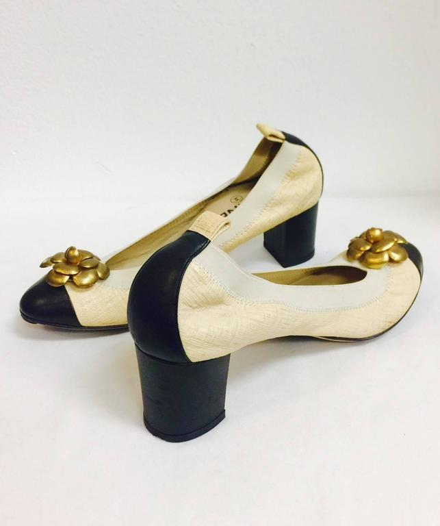 f2f66e2d46 Chanel Black and Tan Pumps With Antique Gold Tone Camellia Ornaments In  Good Condition For Sale