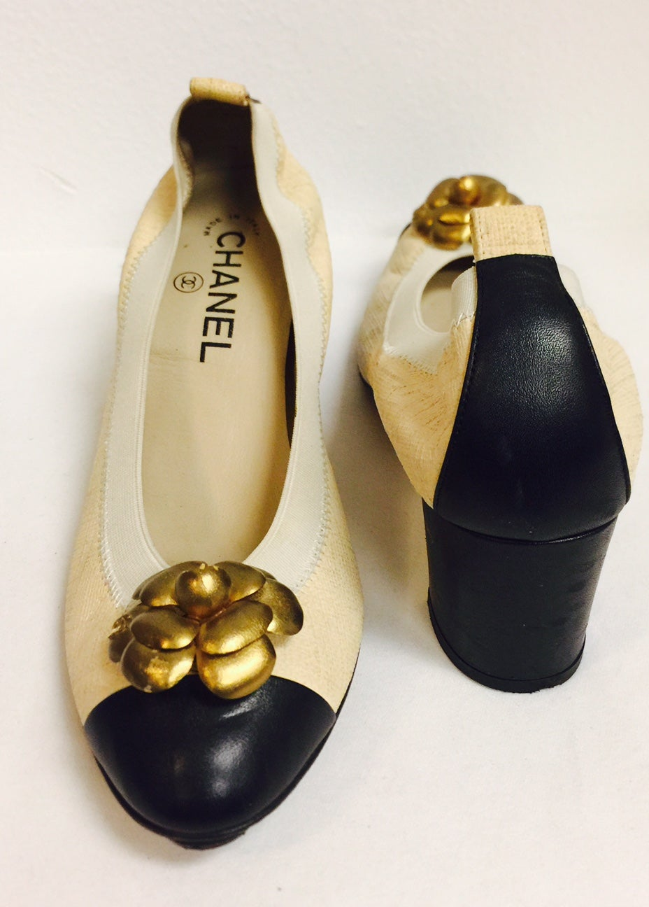 2eb887fa3fb Chanel Black and Tan Pumps With Antique Gold Tone Camellia Ornaments For  Sale at 1stdibs
