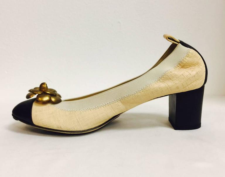 45f8601bd5 Beige Chanel Black and Tan Pumps With Antique Gold Tone Camellia Ornaments  For Sale
