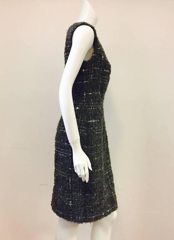 Christian Dior Aubergine, Olive, and White Boucle Wool Blend Tweed Dress is a must for any classically collected woman!  Features ultra-luxurious, substantial fabric, sleeveless design, bateau neckline, and sublime sheath silhouette.  Rear slit.
