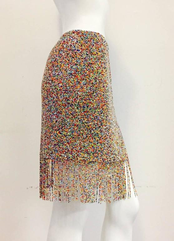 Ralph Lauren Purple Label Collection skirt is undoubtedly inspired by the world renown beading technique of the Maassai!  Features vibrant, multi color beadwork allover.  Weighty?  Yes!  Must be seen to be believed!  Rear hidden zipper with hook and