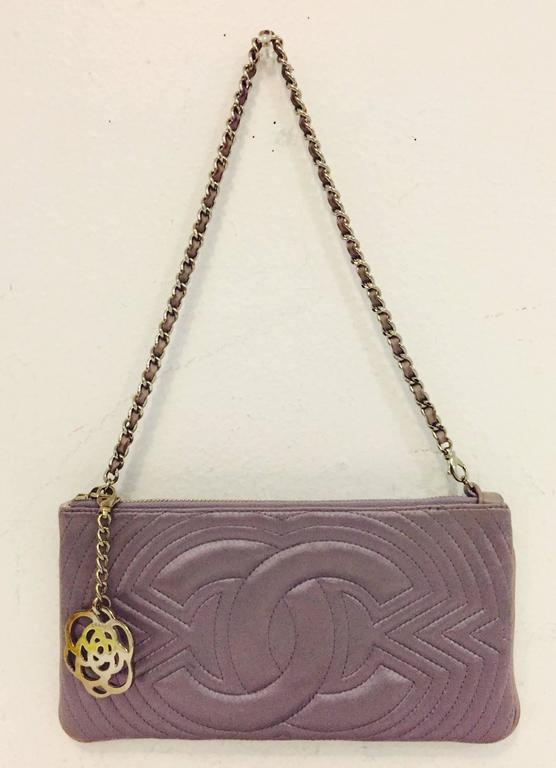 Charming Chanel Small Satin Lavender Clutch proves that Coco is so much more than diamond quilted lambskin shoulder flap bags!  Satin bag has characteristic Chanel leather interwoven silver chain strap.  Look closely, the lavender leather and silver