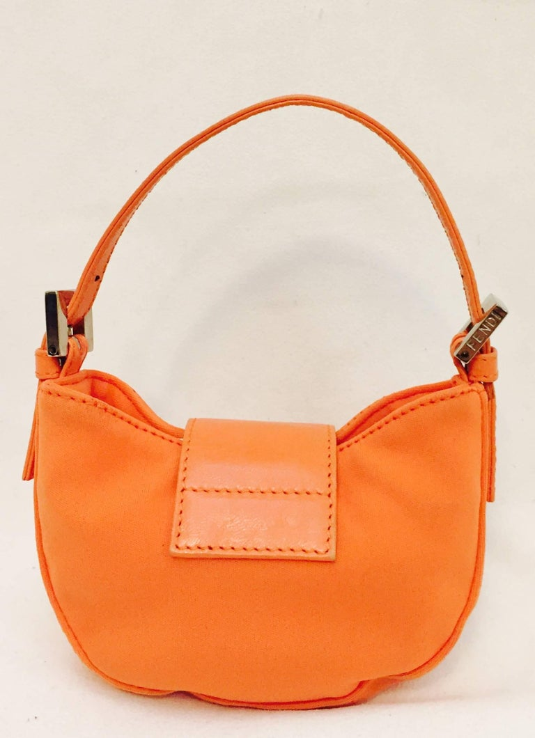 Fendi S Fluorescent Orange Neoprene Mini Croissant Bag Proves That Things Do Come In Small Packages