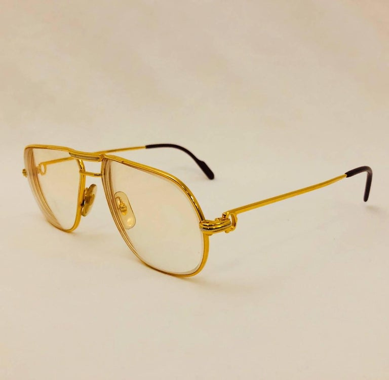 Vintage Cartier Vendome Glasses are highly desired by all connoisseurs of fine eyewear in general and Cartier in particular!     Features gold larger frame, signature temple adornment, and iconic logo temple tips.  Clear Prescription Lenses can be