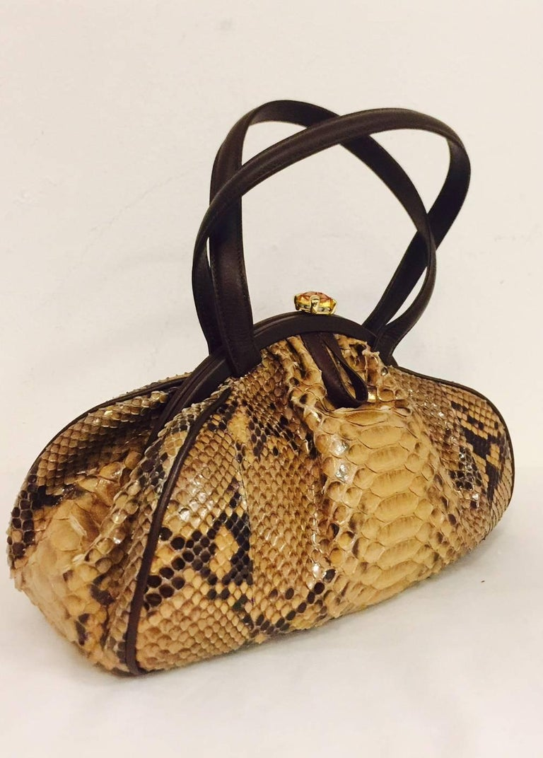 Judith Leiber Gathered Python Frame Hand Bag is fine enough to warrant  Bezel Set Clear Swarovski Crystal Feet!  In Excellent Condition, bag features large python skins and complementary chocolate leather piping, trim and handles.  Square cut