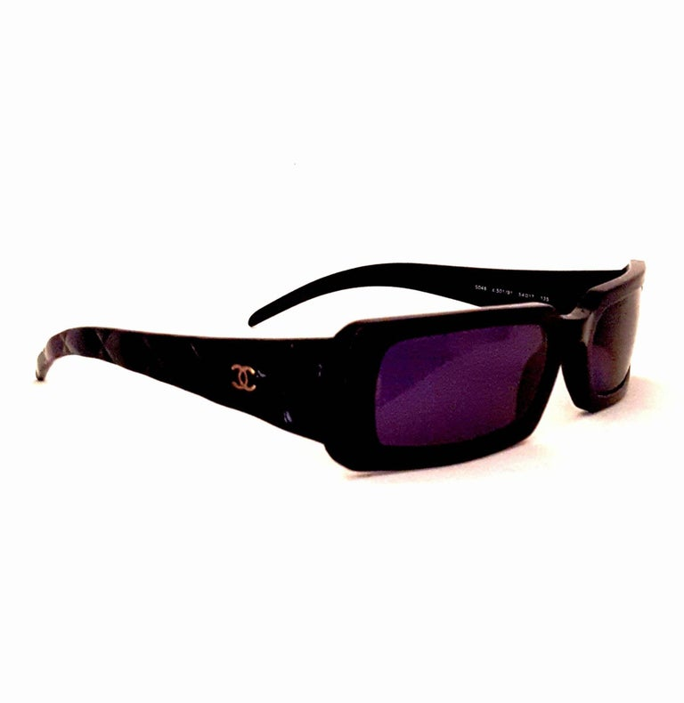 71c19c8d147ec Classy Chanel rectangular sunglasses features Chanel s classic quilting on  the length of the arm as well