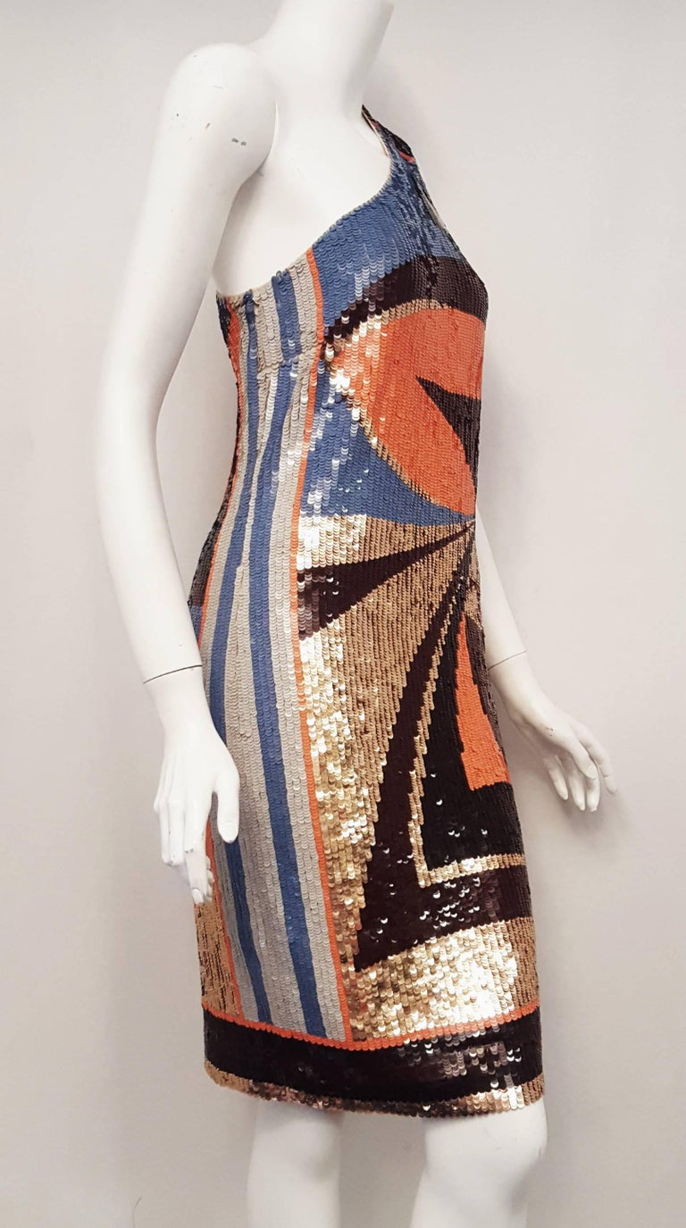 Emilio Pucci sequined artistically designed geometric print could be displayed in any gallery around the world.  This one shoulder glitzy cocktail dress is a fantastic bon voyage gift to yourself for your upcoming holiday trip.  The colors range