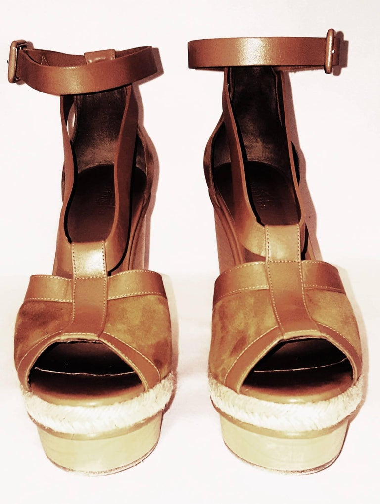 237b28c643bf Hermes tan suede and leather with wooden platform wedge Ibiza sandals have  peep toe opening at