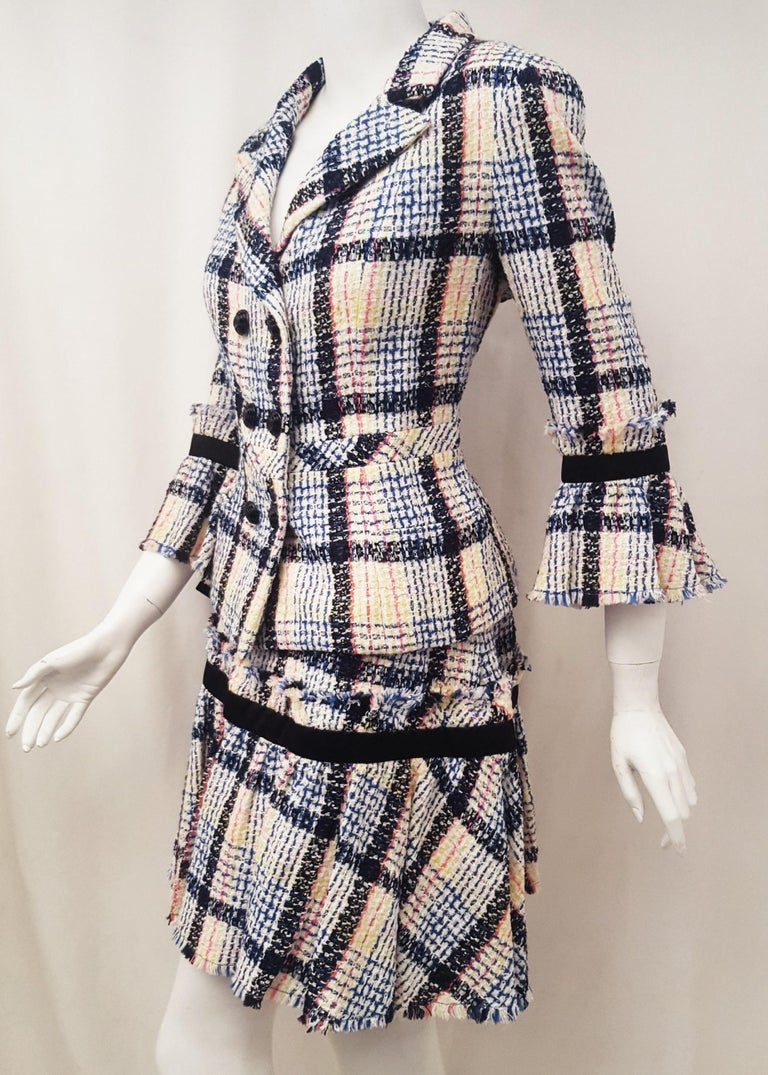 Chanel's ready-to-wear collection is one of the most coveted lines anywhere. And when one thinks of the iconic fashion house, the idea of understated elegance and simplicity certainly comes to mind. This multicolored tweed  skirt suit is designed