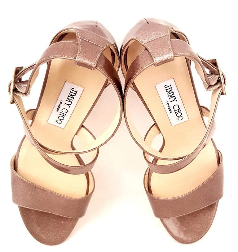 98a2b05393 Jimmy Choo Fearne taupe patent leather with encrusted glitter wedges  contain criss cross straps across the