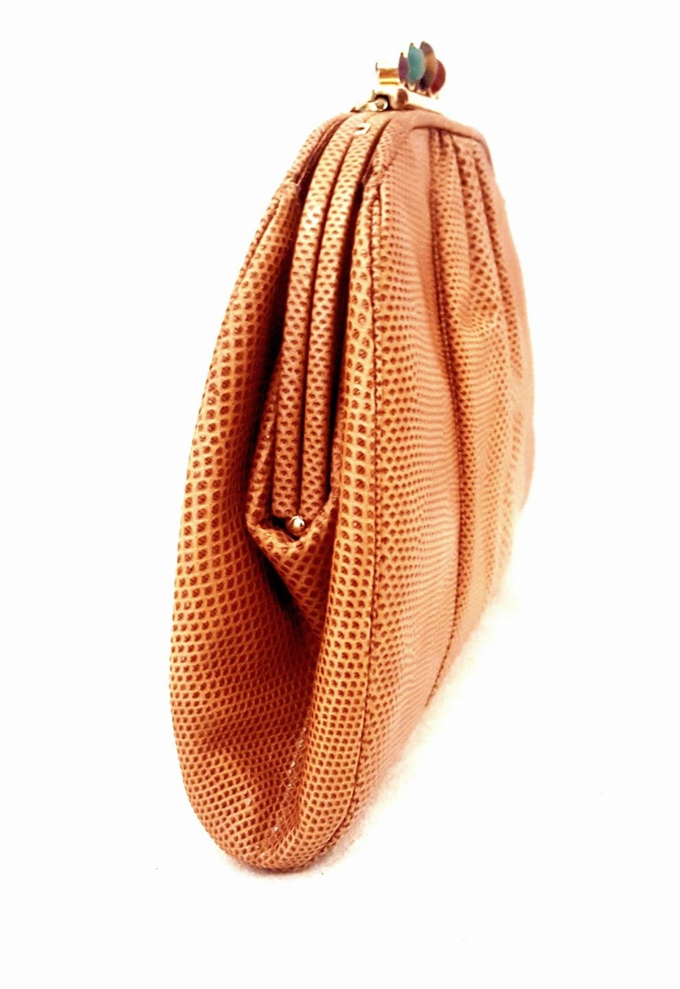 Vintage Judith Leiber jeweled closure tan lizard convertible clutch/shoulder bag is highly desired by collectors of Judith Leiber.   This bag features slightly gathered, butter soft lizard skin.  It is larger than the typical Lebeir that easily