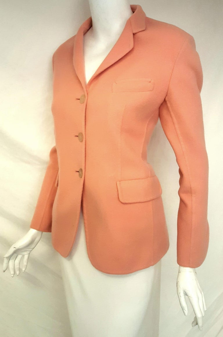 Jil Sander pink salmon cashmere single breasted jacket features a 3 button front closure.   This notch collar blazer has two flap pockets and one faux top pocket.  The jacket is only lined at shoulders and partial top front of jacket.  The sleeves