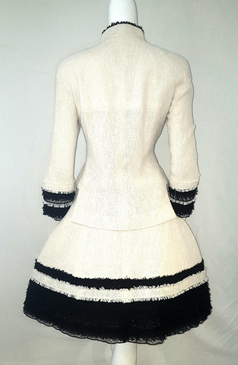 Chanel Ivory W/ Black Fringe & Lace Trim on Sleeves & Skirt Hem Suit In Excellent Condition For Sale In Palm Beach, FL