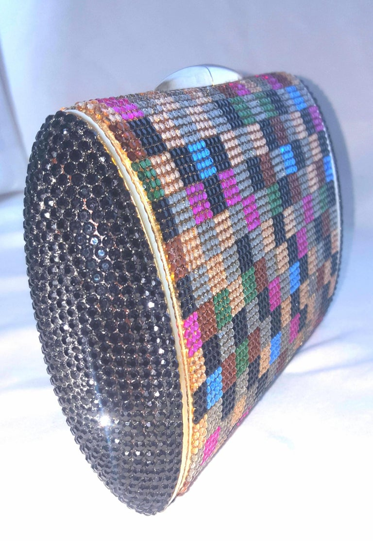 Judith Leiber multi colored art deco squares crystal evening clutch includes a chain shoulder strap in gold tone. Judith Leiber creations are found in permanent collections at The Victoria and Albert Museum in London, The Metropolitan Museum of Art