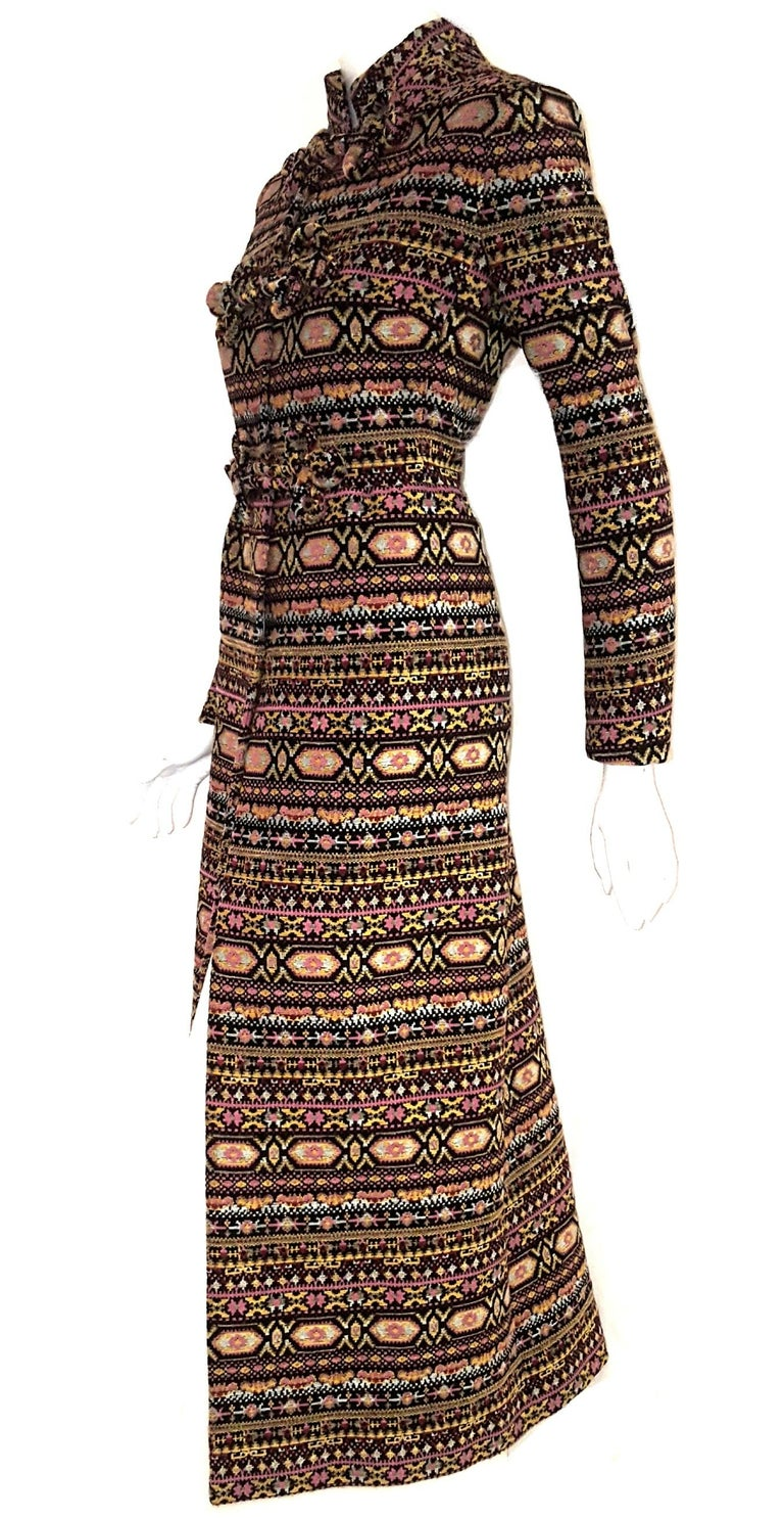 Valentino tapestry pattern long coat from the 2012/2013 fall/winter runway collection with heavy damask fabrics that recall 19th century tapestry ala Botticelli or optical patterns is typical of the 60's coutoure woman.  Micro and macro patterns for