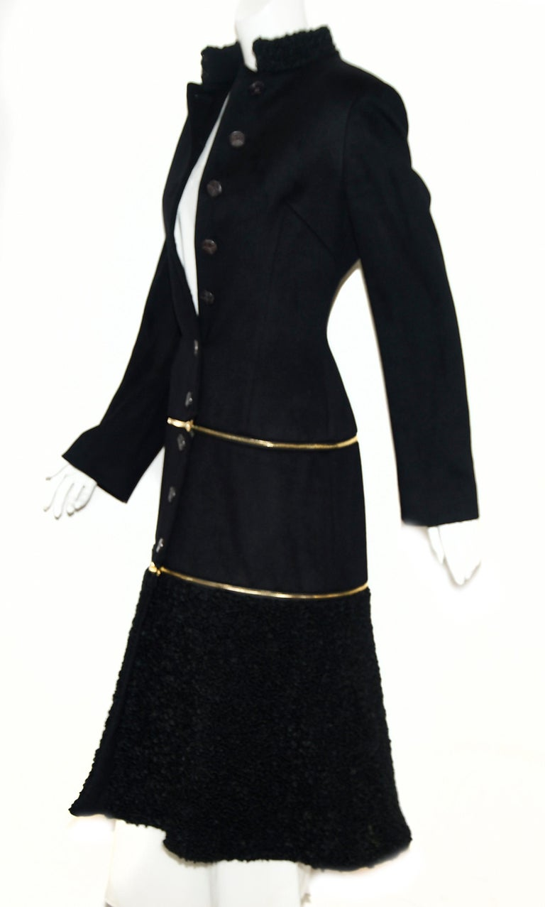Alexander McQueen coats not only combine quality with sleek design, they command attention. This adaptable coat can be converted from full length coat to coat to jacket.  Each segment is separated by an exposed gold tone zipper.   Walk into any room