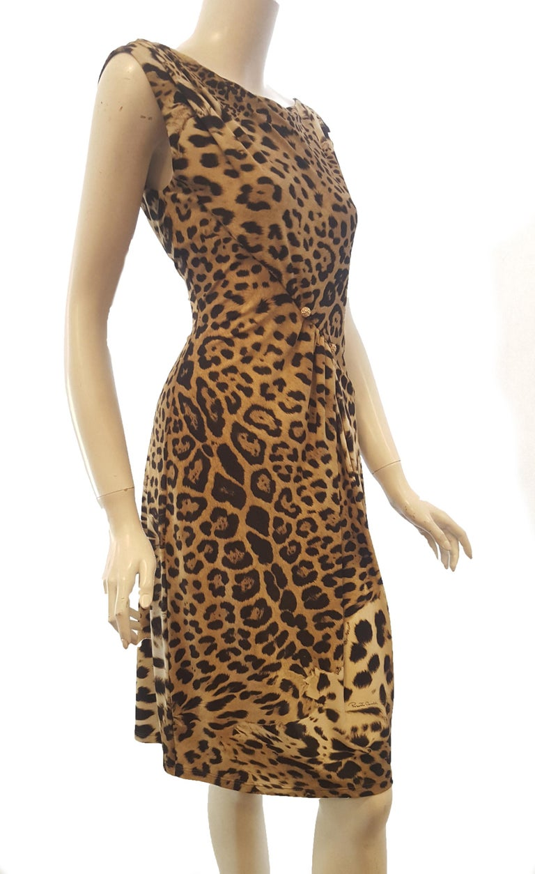 Roberto Cavalli sleeveless black and beige leopard print includes two gold tone and crystal buttons asymmetrically placed on the waistline.   The dress is partially ruched at front below the waist.   The top of this dress is lined and draped.  Dress