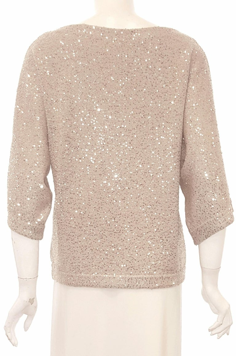 Oscar de la Renta bateau neckline and dolman sleeve statement sweaters are utterly of the moment. This beautiful design from Oscar de la Renta's from the 2013 cruise runway is designed with tiny sequins for a shimmering finish.  Continuing with  the