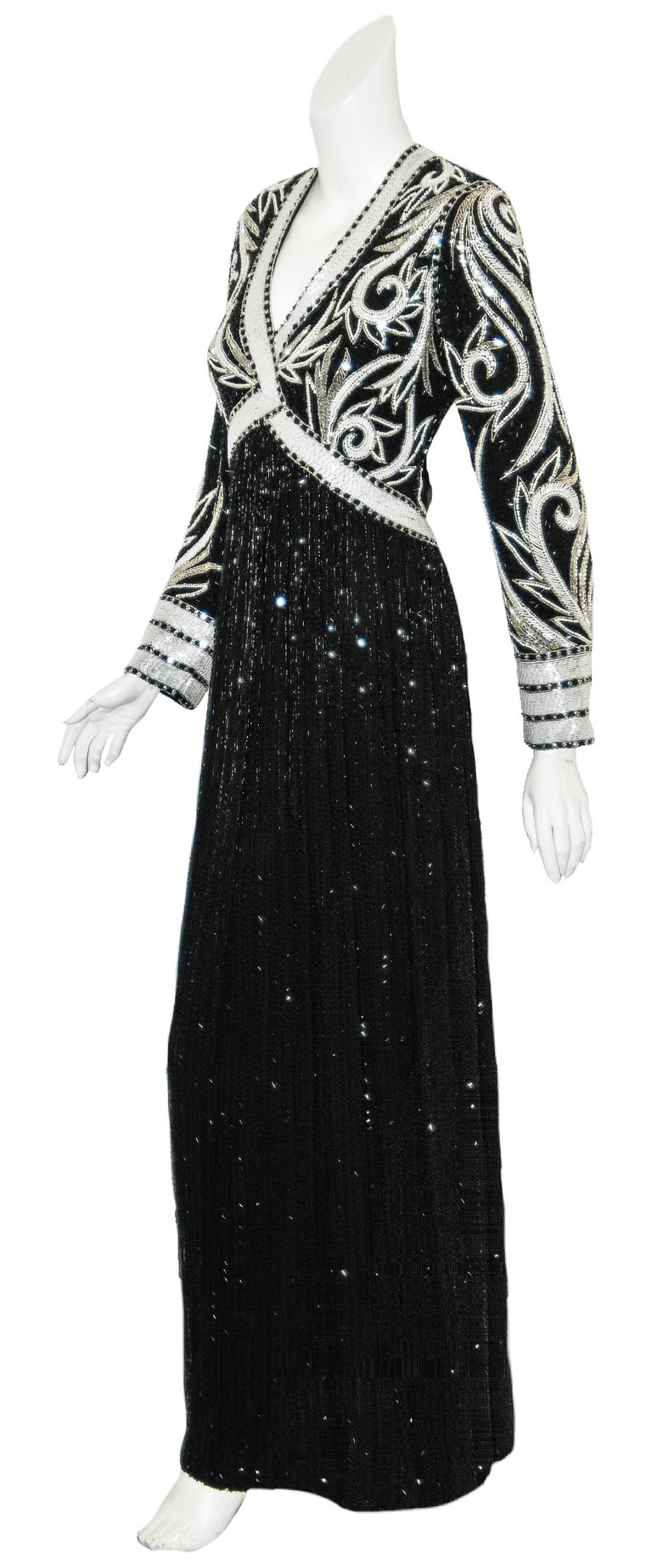 Bob Mackie black and white long sleeves spiral print fully beaded gown is in mint condition.  Mackie, best known for his top designer relationship with Cher, also designs gowns and stunning dresses for special occasions for elegant ladies!  This