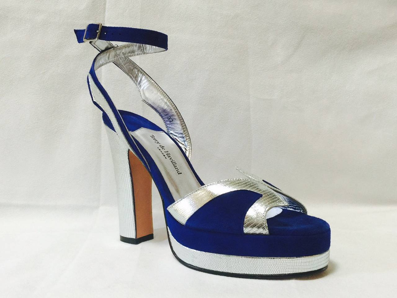 New Terry de Havilland Stacked High Heel Sandals are worthy of Studio 54!  Exquisite, blue suede is perfectly complemented by luxurious silver python heels, platforms, and decorative details!  Features also include peep toe, adjustable ankle strap,