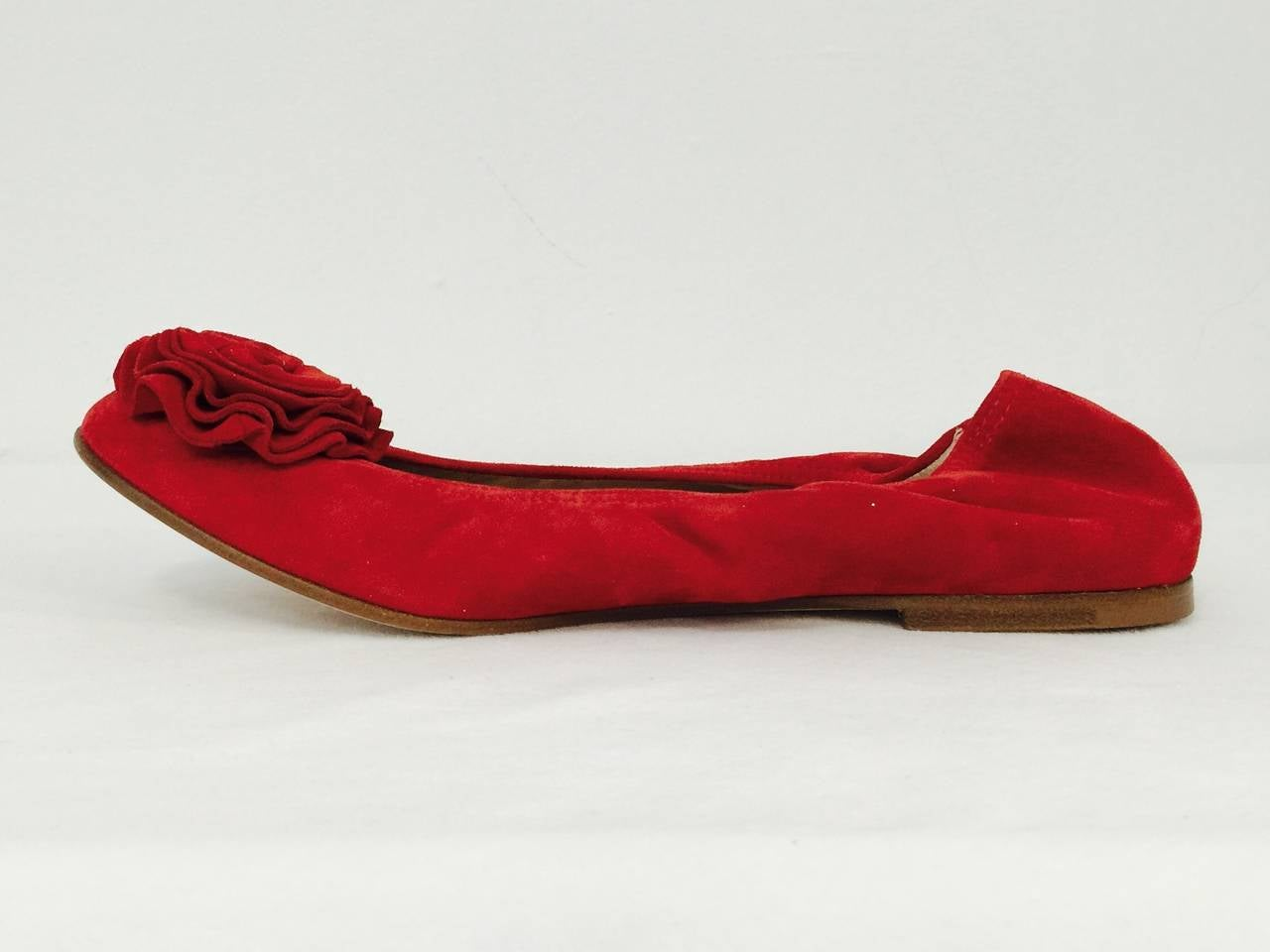 Worn after performances at the Kirov or New York City Ballet, these Valentino Garavani Red Suede Ballerina Flats are in full bloom!  Features ultra-luxurious gathered suede and leather soles.  Leather insoles and lining.  The pieces de resistance?