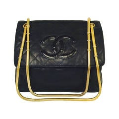 1990s Chanel Black Quilted Lambskin Shoulder Bag With Serpentine Strap