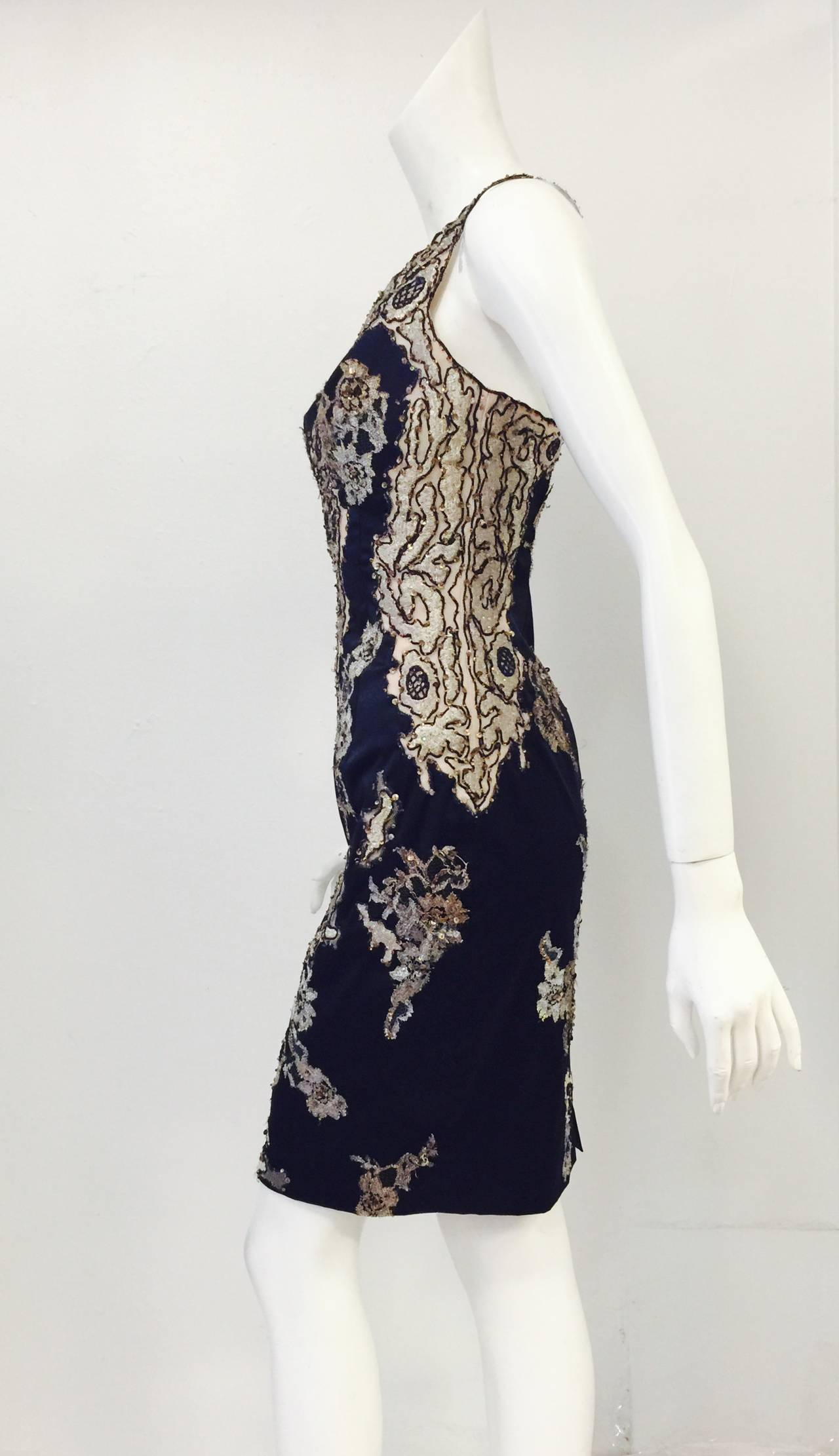 Brand New Mandalay Beaded Cocktail Dress in Midnight Blue will make any Cocktail Hour Special!  Crafted from signature luxurious stretch fabric, dress features v-neckline, spaghetti straps, and above-the-knee length.  Exquisite applique technique