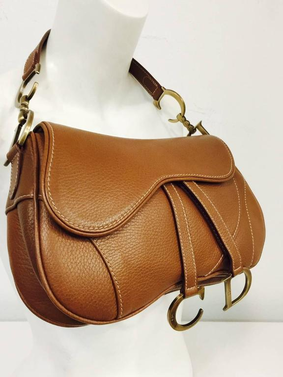 Christian Dior Double Saddle Bag has become one of the most recognizable  shapes and highly coveted