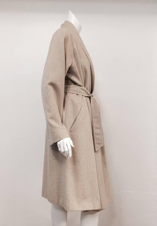 Max Mara Belted Coat  is pure luxury defined!  Features supremely soft cashmere in timeless tan.  Raglan sleeves, two slanted welt pockets, shawl collar and pick-stitched belt complete this classic look.  Fully lined in viscose with oversized