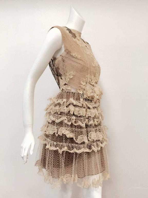 "Mocha Latte Lace Sleeveless Cocktail Dress illustrates why ""Le Chic"", Valentino Garavani, is one of the world's most celebrated haute couturiers.  A true confection, this cocktail dress is crafted from exquisite mocha fabric enhanced with cream"