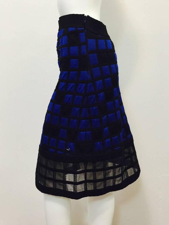 Chanel Colorblocked Quilted Skirt is as modern as Coco herself!  Features classic A-line silhouette rendered in luxurious, technologically advanced quilted black and royal blue fabric  Squares and rectangles all over are perfectly complemented by