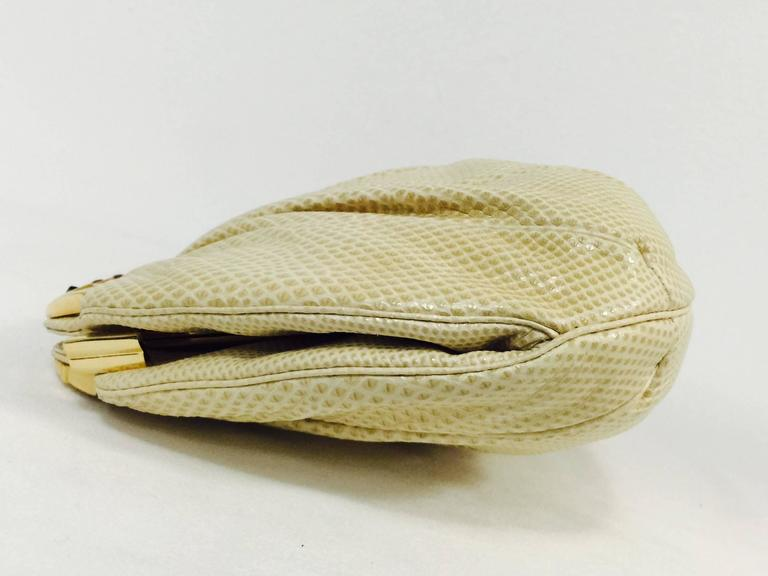 Vintage Judith Leiber Bejeweled Tan Lizard Convertible Clutch is highly desired by all collectors of Judith Leiber! Features slightly gathered, butter-soft lizard skin. Larger than the typical Leiber bag, easily converts from clutch to shoulder bag