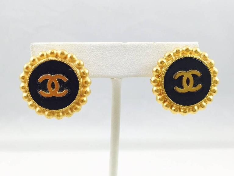 Round clip on earrings are a staple for any devotee of Chanel costume jewelry!  These gold tone button earrings feature the world renowned double