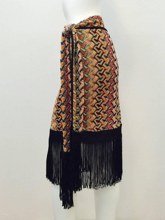 "This Knit Straight Skirt is undeniably Missoni!  Crafted from signature multi color knit, skirt features elongated side tie that is whimsically finished with over 8"" of black fringe.  The ""Wow Factor""?  Skirt's hem is also finished with same black"