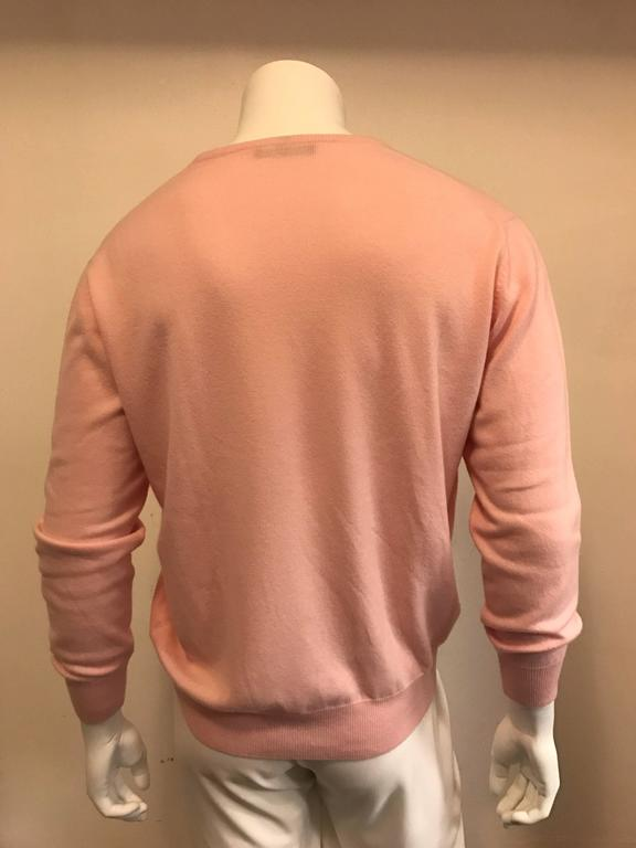 This soft pink Loro Piano is sumptuously luxurious in baby cashmere. The V neck measures approximately a 7
