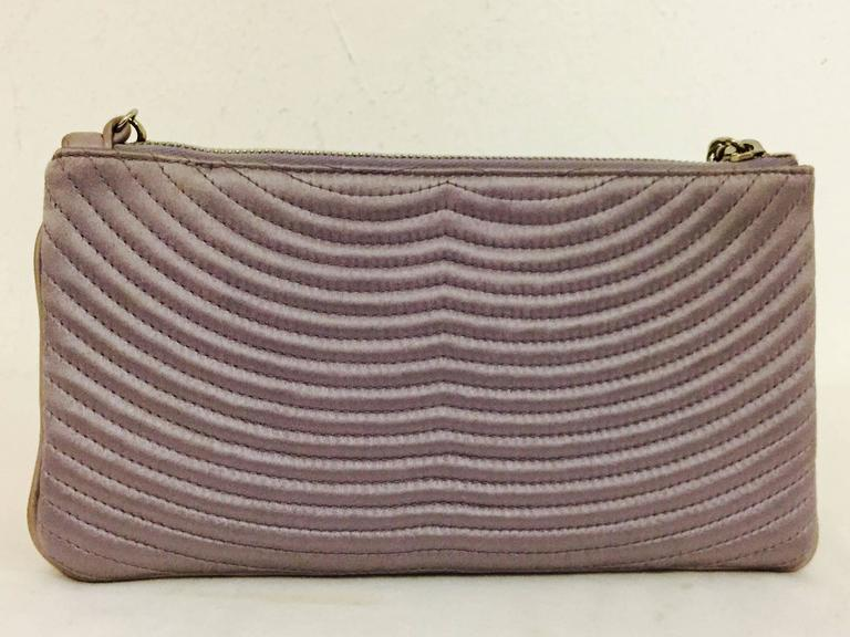 Women's Chanel Small Satin Lavender Clutch with Metal Charm For Sale