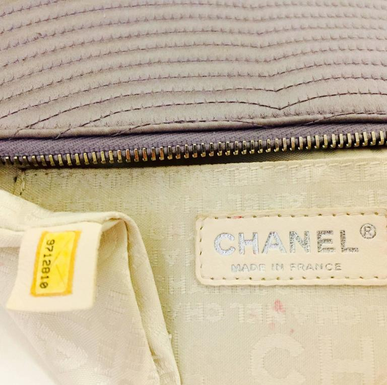 Chanel Small Satin Lavender Clutch with Metal Charm For Sale 1