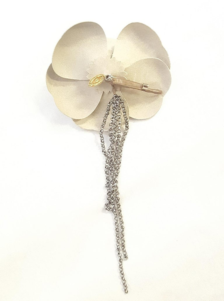 Contemporary Chanel Beige Leather Camellia Flowers with Pewter Tone Chain Link Fringe Decor For Sale
