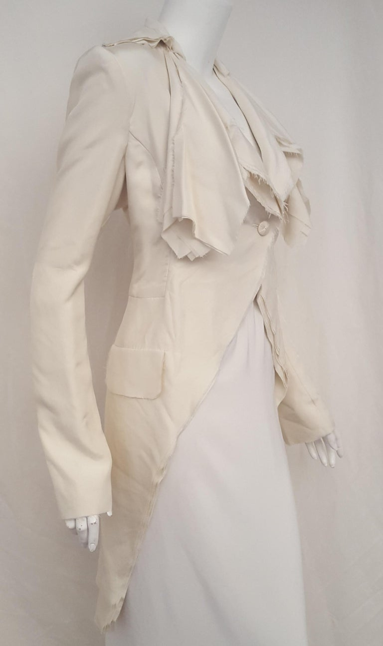 Alexander McQueen Habotai winter white silk coat is a stunning display of signature craftsmanship as it is composed from ten layers of silk-habotai with frayed edges!  Yes, we said 10 layers of soft, self indulgent silk making it a striking coverup
