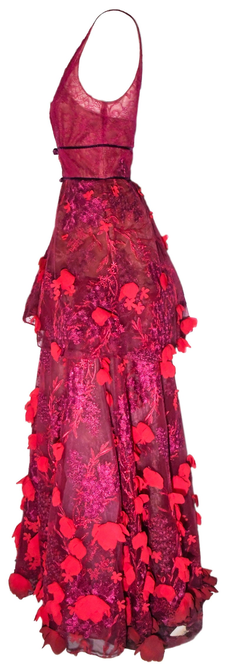Marchesa Notte selection of couture evening gowns and cocktail dresses has become a firm favorite of  A listers on the red carpet thanks to show stopping embroidery and dazzling embellishments. Presented in a vibrant red tone, this V neck floral
